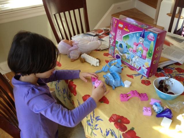 Ayelet building her Lego Friends Cinderella set