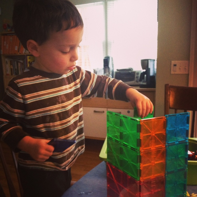 My two-year-old son building with Magna-Tiles